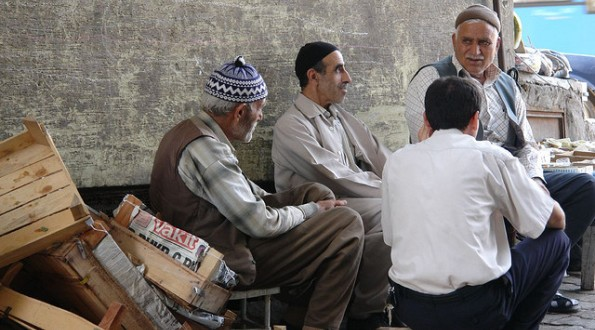 Men sitting in the late afternoon sun in Diyarbakir, southeastern Turkey.