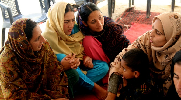 Kashmiri women discussing women's rights following the 2005 earthquake in Pakistan.