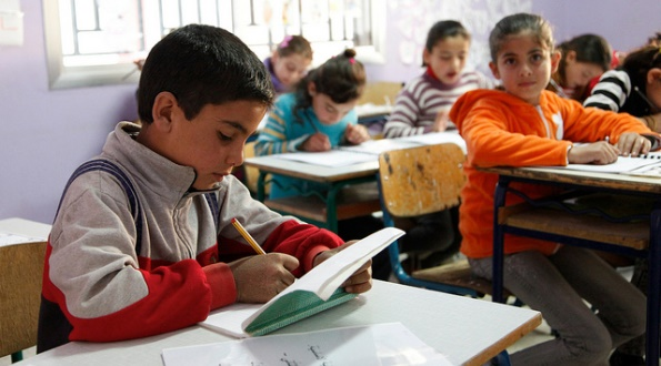11-year old boy from Syria, in school in Lebanon's Bekaa Valley, close to the border with Syria.