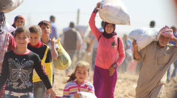 Massive influx of Syrian Kurdish refugees into Turkey.