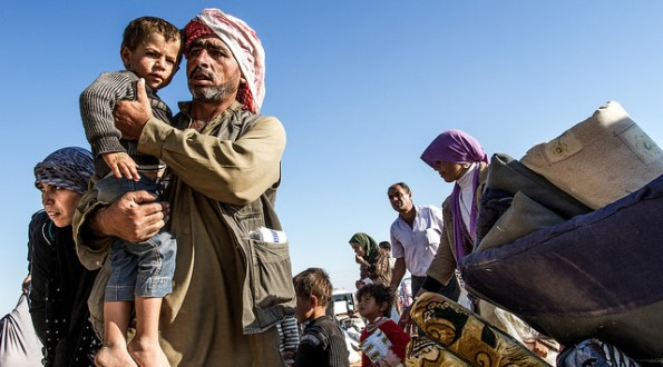 Refugees from Kobane escape from the attacs of IS to the Turkish side, September 2014.